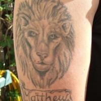 Lion head memorial tattoo