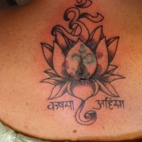 Lotus flower with hindu writings tattoo