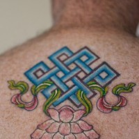 Infinity knot with lotus tattoo