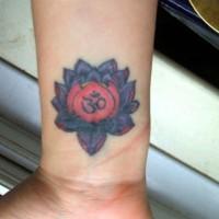 Dark purple lotus tattoo on wrist
