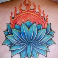 Blue lotus in flame tattoo