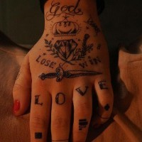 Full hand tattoo with knife diamond and writings