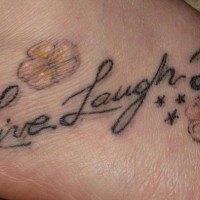 Love live laugh tattoo on foot