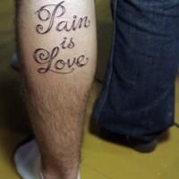 Pain is love tattoo on leg