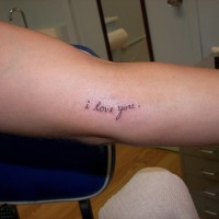 Small i love you text tattoo on arm