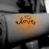 Love lettering with heart tattoo