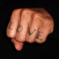 Love word tattoo on knuckle