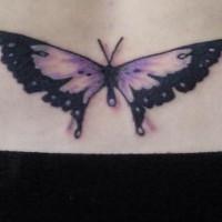 Lower back tattoo,violet  flattened butterfly