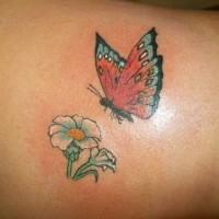 Lower back flower tattoo, flying beautiful butterfly