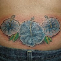 Lower back blue hibiscus tattoo