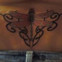 Lower back tribal big dragonfly tattoo
