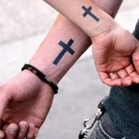 Matching latin cross wrist tattoos