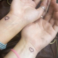 Matching heart on wrist tattoo