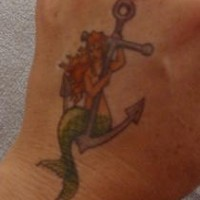 Mermaid  on anchor small tattoo on hand