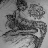 Highly detailed mystery mermaid tattoo