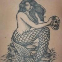 Mermaid with skull black ink tattoo