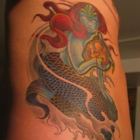 Blue mermaid with golden mask  tattoo