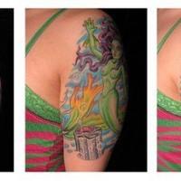 Green mermaid tattoo on shoulder