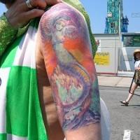 Surreal mermaid coloured tattoo