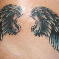 Tattoo of metallic angel wings