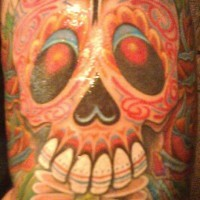 Red sugar skull with flower tattoo