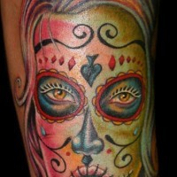 Girl face with sugar skull make up tattoo