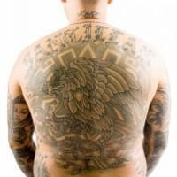 Large eagle with snake aztec style tattoo on back