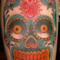 Sugar skull with realistic heart tattoo