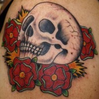 Mexican style skull and roses tattoo
