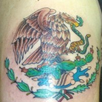 Eagle eating snake with cactuses tattoo