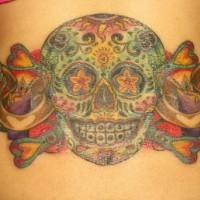 Dia de muertos colourful skull tattoo on lower back
