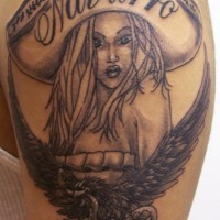 Girl in sombrero with eagle tattoo
