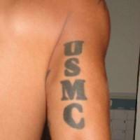 Usmc writing tattoo on arm