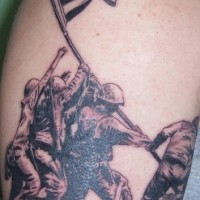 Military photo of soldier and flag tattoo