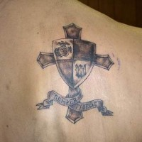 Cross with army shield tattoo on shoulder