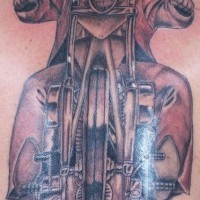 Lone rider on motorcycle tattoo