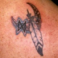 Feather and moon crescent tattoo