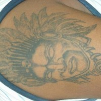 Indian chief in feather crown tattoo