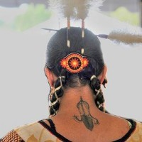 Native american tattoo of feather on neck