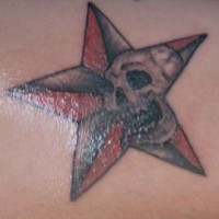 Red and black star with skull tattoo