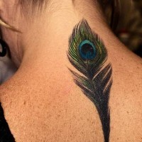Detailed peacock feather tattoo on neck