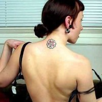 Girly flower tattoo on neck