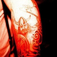 Traditional arm tattoo art of viking warrior