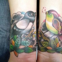 Colorful traditional tattoo with birds on hands