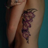 Pink orchid flowers tattoo on side