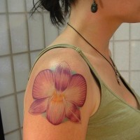 Pink orchid flower tattoo on shoulder