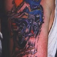 Gangster with red girl on motorcycle tattoo