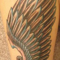 Tattoo with paper clipped wing