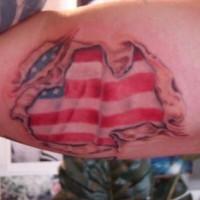 Usa flag under skin rip tattoo on arm