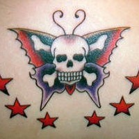 Pirate skull on butterfly tattoo